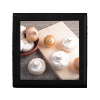 Raw champignon mushrooms and onions jewelry boxes