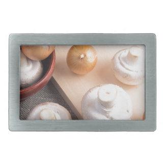 Raw champignon mushrooms and onions rectangular belt buckles