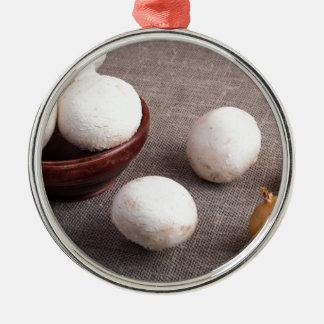 Raw champignon mushrooms and onions Silver-Colored round ornament