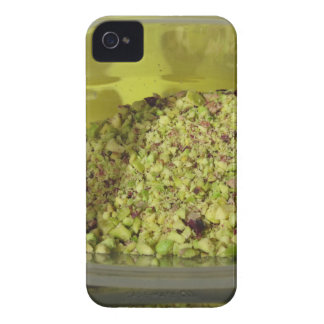 Raw chopped pistachios in a plastic food pan iPhone 4 covers