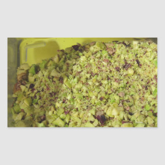 Raw chopped pistachios in a plastic food pan sticker