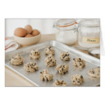 Raw cookies on baking tray greeting cards