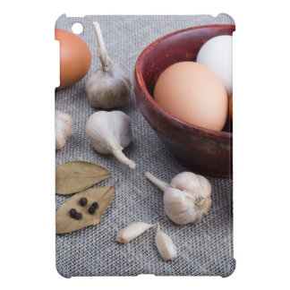 Raw eggs and garlic and spices on the kitchen iPad mini case