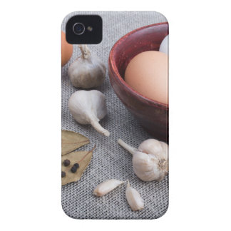 Raw eggs and garlic and spices on the kitchen iPhone 4 Case-Mate cases