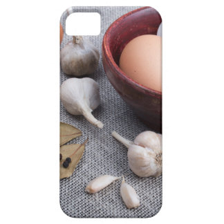 Raw eggs and garlic and spices on the kitchen iPhone 5 case