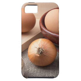 Raw eggs, onions and garlic on a background iPhone 5 case
