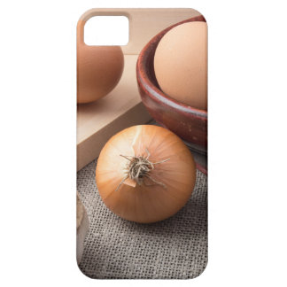 Raw eggs, onions and garlic on a background iPhone 5 cases