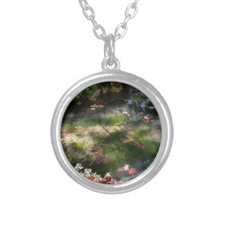 rays and leaves on water silver plated necklace