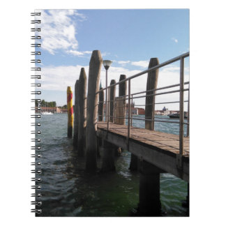 Ready to sail? View along a pier to the water. Notebooks