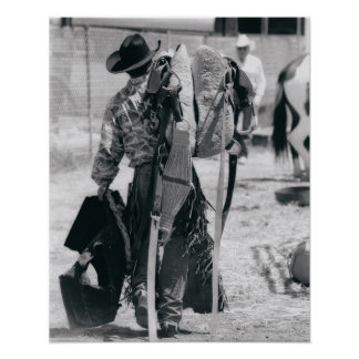 Rear view of cowboy hauling gear poster