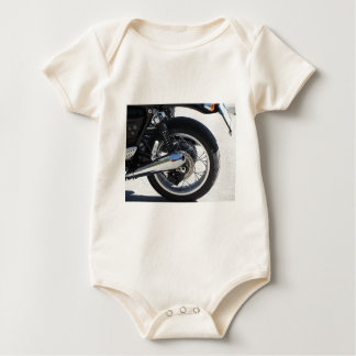 Rear wheel and chromed exhaust pipe of motorcycle baby bodysuit