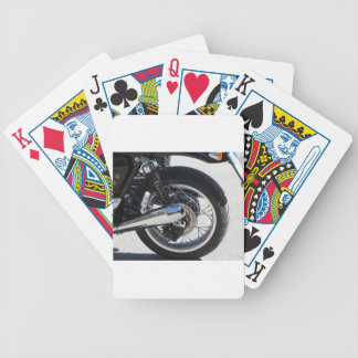 Rear wheel and chromed exhaust pipe of motorcycle bicycle playing cards