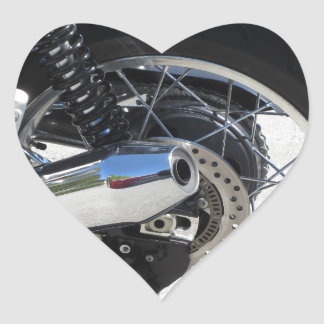 Rear wheel and chromed exhaust pipe of motorcycle heart sticker