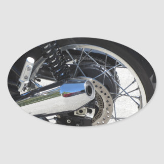 Rear wheel and chromed exhaust pipe of motorcycle oval sticker