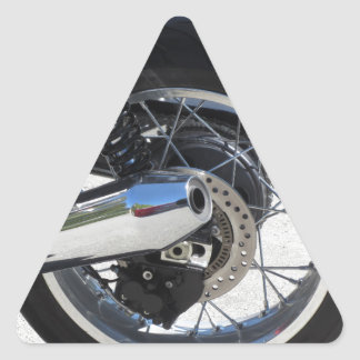 Rear wheel and chromed exhaust pipe of motorcycle triangle sticker