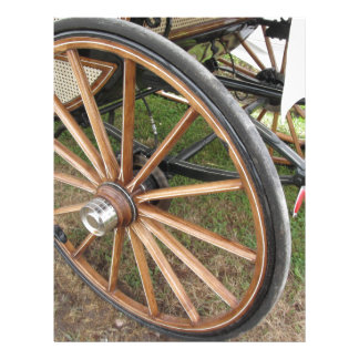 Rear wheels of old-fashioned horse carriage letterhead