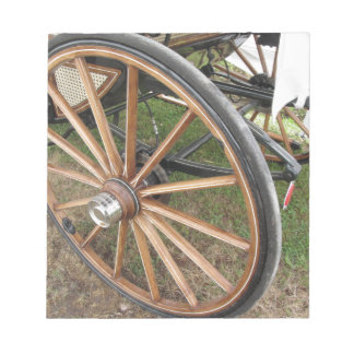 Rear wheels of old-fashioned horse carriage notepad