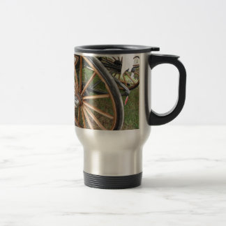 Rear wheels of old-fashioned horse carriage travel mug