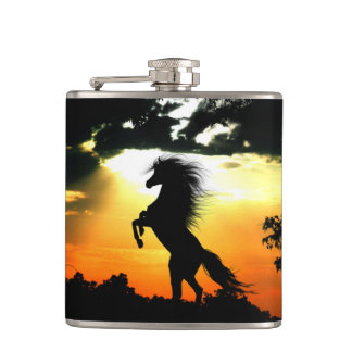 Rearing horse at sunset hip flask