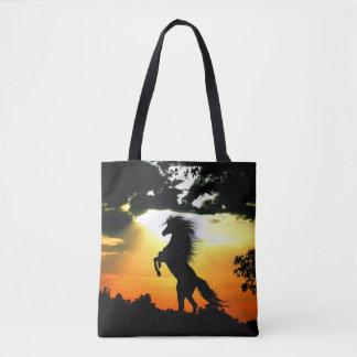 Rearing horse at sunset tote bag