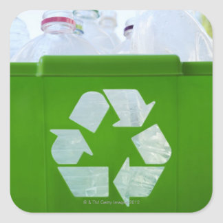 Recycling logo cut out of green plastic square sticker