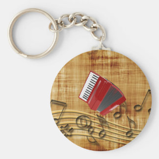 Red accordion, black notes, gold background keychain