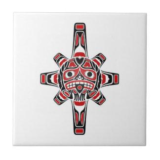 Red and Black Haida Sun Mask on White Tiles