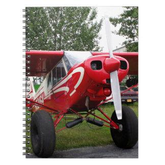 Red and white aircraft, Alaska Spiral Notebook