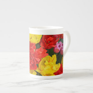 Red and yellow spring tulips tea cup
