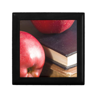 Red apples and old vintage book gift box
