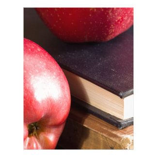 Red apples and old vintage book letterhead