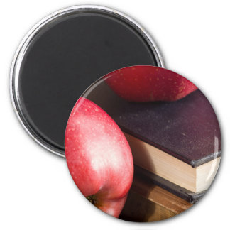 Red apples and old vintage book magnet