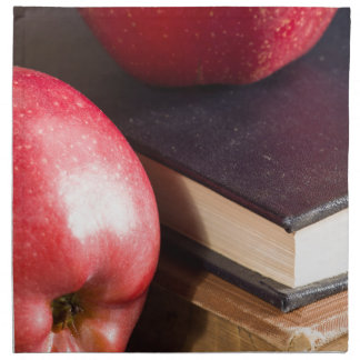 Red apples and old vintage book napkin