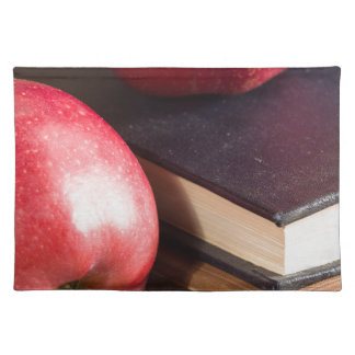 Red apples and old vintage book placemat