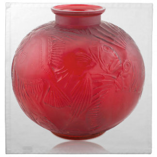 Red Art Deco glass vase with fish design. Napkin