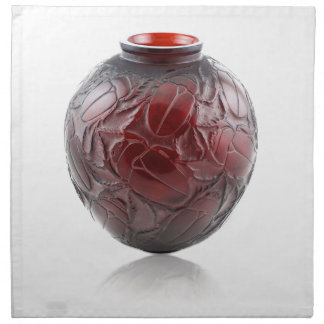 Red Art Deco glass vase with scarabs. Napkin