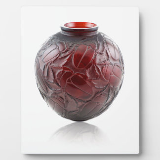 Red Art Deco glass vase with scarabs. Plaque