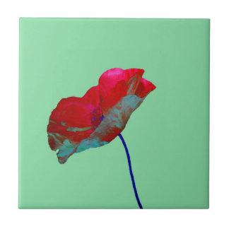 Red blue poppy on emerald green tile