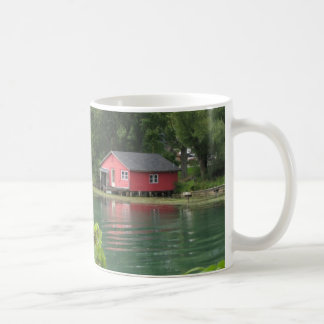 red boat house on canal coffee mugs