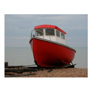 Red boat on the beach postcard