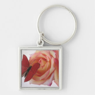 red butterfly on pink rose premium keychain