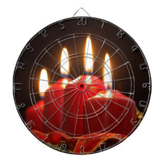 Red candles of an Advent wreath with fir branches Dartboard