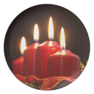Red candles of an Advent wreath with fir branches Plate