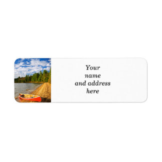 Red canoe on lake shore return address label