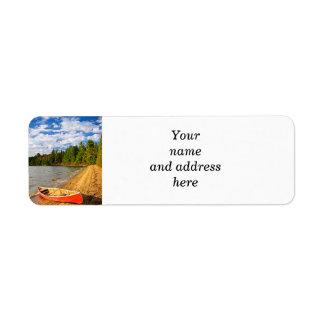Red canoe on lake shore return address label