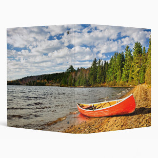 Red canoe on lake shore vinyl binders