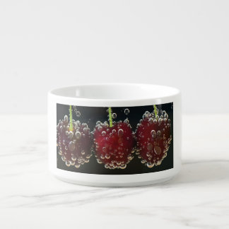 Red cherries in the water bowl