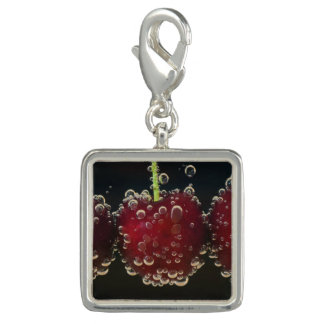 Red cherries in the water charm