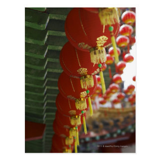 Red Chinese lanterns hanging from temple Post Cards