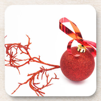 Red christmas ball with twig on white background coaster